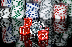 Dice and chip. Red dice and chips background Stock Photo