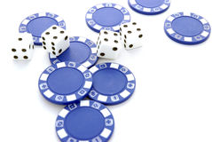 Dice and chips. Four dices on top of blue poker chips and white backcground Royalty Free Stock Photography
