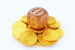 Dice and chocolate coins Stock Photo