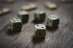 Dice closeup on a wooden table Royalty Free Stock Images
