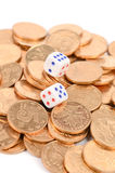 Dice and coin Stock Images