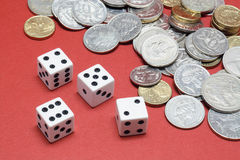 Dice and Coins Stock Photos