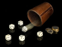 Dice and coins. Royalty Free Stock Images