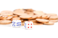 Dice and coins Stock Photography