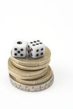 Dice and coins Royalty Free Stock Image