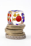 Dice and coins Stock Images