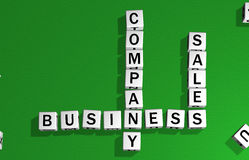 Dice company, business and sales. Dice on a green carpet making the word business, sales and company Stock Images