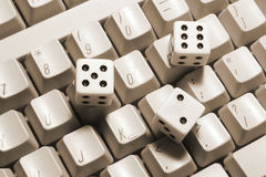 Dice on  Computer Keyboard Royalty Free Stock Images