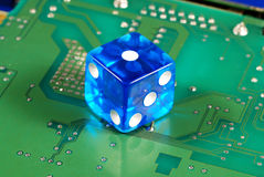 Dice on a computer motherboard Stock Photos