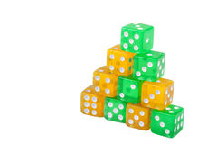 Dice concept. Pyramid symbol made of dices Royalty Free Stock Photography