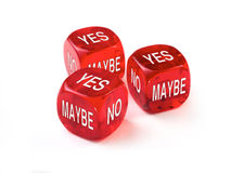 Dice Concept. Yes, No, Maybe concept with three red dice on a white background Royalty Free Stock Image