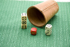Dice cup. Of leather with die Royalty Free Stock Images