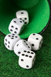 Dice from a cup. Rollin dice coming from a cup Royalty Free Stock Photo
