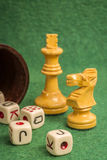 Dice Cup with Chess Pieces Royalty Free Stock Photo