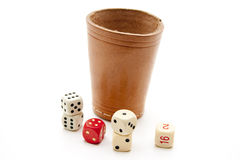Dice cup with cube Stock Images