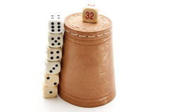 Dice cup with cube Stock Photos