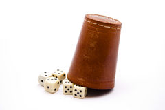 Dice cup with cube. On white background Stock Photos