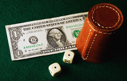 Dice cup dollar Royalty Free Stock Photography
