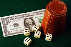 Dice cup dollar Royalty Free Stock Images