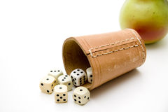 Dice cup with pear. Dice cup of leather with die Stock Image