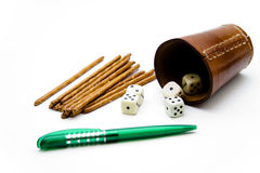 Dice cup with saltsticks Royalty Free Stock Image