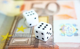 Dice and Currency. A pair of dices and money Royalty Free Stock Photos