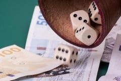 Dice and danish money Stock Photos