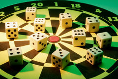 Dice on Dart Board Stock Photo