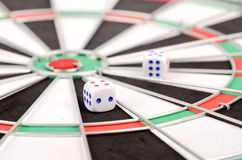 Dice and dart board Stock Image