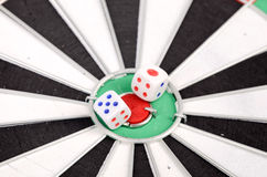Dice and dart board Stock Photography