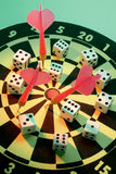 Dice and Darts on Dart Board Stock Photos