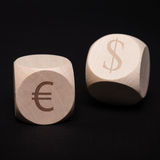 Dice with dollar and euro symbol Royalty Free Stock Image