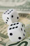 Dice on dollars. (Business concept royalty free stock images