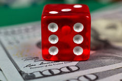 Dice on dollars Stock Photo