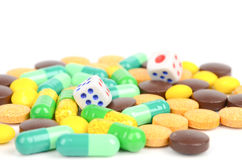 Dice and drug Stock Images
