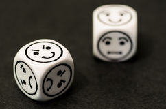 Dice with emoticon sides Stock Photos