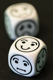 Dice with emoticon sides Royalty Free Stock Photo