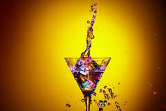 Dice Fall In A Glass Of Martini. Colourful Cocktail In Glass With Splash Royalty Free Stock Image