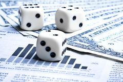 Dice on financial chart near dollars Royalty Free Stock Photography