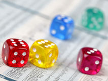 Dice on financial report. Colorful dice on financial report Royalty Free Stock Images
