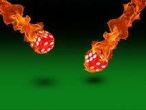 Dice in a fire. casino concept Royalty Free Stock Images