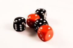 Dice. Five black and red dice on a table Royalty Free Stock Photos