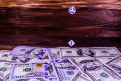 Dice in a flight above the one hundred dollar bills. Gamble conc Stock Images