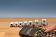 Dice form the German word `STEUERN` stock images
