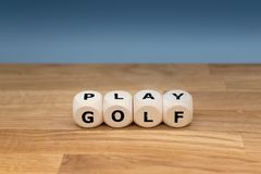 Dice form the words `PLAY GOLF.