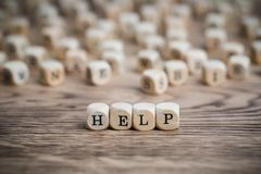 Dice forming the word HELP stock images