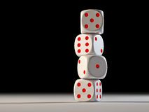 Dice. Four dices balancing on each other on black background Stock Photography