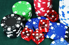 Dice in gambling chips Stock Photography