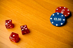 Dice and gambling chips Stock Photography