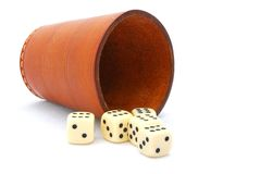 Dice game. An old used leather dice cup with five winning dice. Image isolated on white studio background Royalty Free Stock Photos
